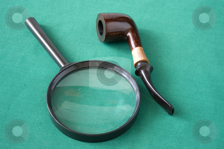 Magnifying glass and pipe stock photo, Magnifying glass and pipe ob green background by Minka Ruskova-Stefanova