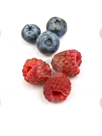 Raspberry and Blueberry stock photo, Raspberries and blue berries on a white background by John Teeter