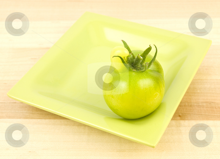 Tomato with unusual growth stock photo, Tomato with unusual growth off the top of it. by John Teeter