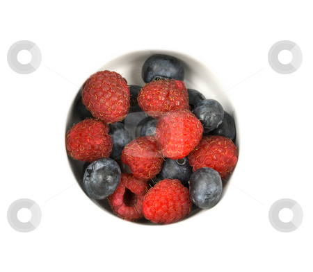 Raspberries and Blueberries stock photo, Raspberries and blue berries on white with copyspace by John Teeter