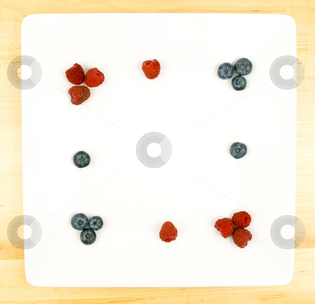 Fruit Plate stock photo, Fruit Plate with raspberries, blue berries and copy space by John Teeter