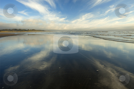 California Cirrus Explosion stock photo, A cirrus cloud appears to explode across the late afternoon sky and reflect on the wet samd on a Northern California Beach near Arcata. by Mike Dawson