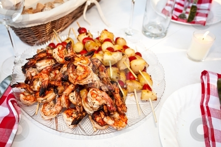 Kebabs stock photo, Kebab refers to a variety of meat dishes in Mediterranean, Caucasian, Central Asian, South Asian and some of the African cuisines, consisting of grilled or broiled meats on a skewer or stick. by Mariusz Jurgielewicz