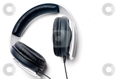 Tilted horizontal image of silver colored headphones with black  stock photo, Tilted horizontal image of silver colored headphones with black leather padding by Vince Clements