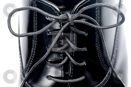 A horizontal close up of laces on a black leather business shoe stock photo, A horizontal close up of laces on a black leather business shoe by Vince Clements