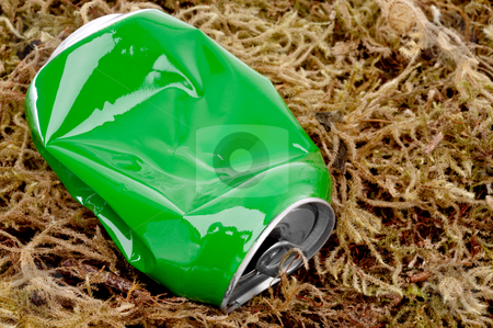 Horizontal close up of a crushed green aluminum drink can on mos stock photo, Horizontal close up of a crushed green aluminum drink can on moss by Vince Clements