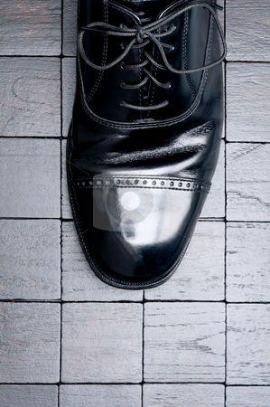 Black leather business shoe on a dark background stock photo, Black leather business shoe on a dark background by Vince Clements
