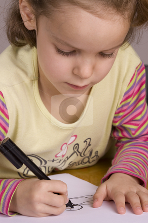 Girl drawing stock photo, Girl Drawing with a black pen by Jandrie Lombard