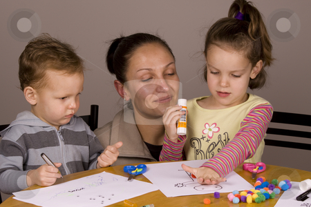 Family fun stock photo, Mother and kids spending time together doing arts and craft by Jandrie Lombard