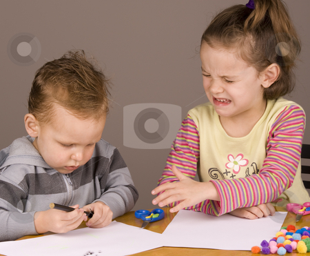 Girl crying stock photo, Girl crying because her brother took her pen by Jandrie Lombard
