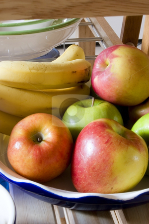 Apples and Bananas stock photo, Bowl of apple and banana by Mehmet Dilsiz