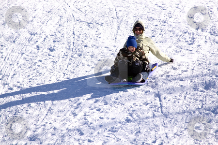 Mother and Son Sledding down the Hill stock photo, Mother and Son Sledding down the Hill - Winter Scenes by Mehmet Dilsiz