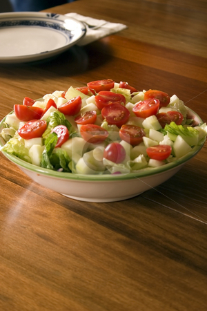 Bowl of Salad and an Empty Plate on the Background stock photo, Bowl of Salad and an Empty Plate on the Background by Mehmet Dilsiz