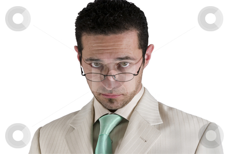 Businessman looking over his glasses stock photo, Isolated businessman looking over his glasses by Mehmet Dilsiz