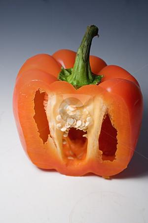 Isolated Half Cut Orange Pepper stock photo, Isolated Half Cut Orange Pepper on a Blue White Background by Mehmet Dilsiz