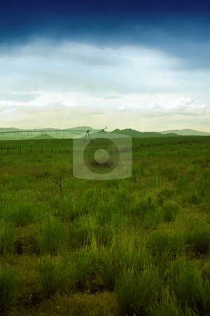 Irrigation System in the Field stock photo, Irrigation System in the a Filed - Foggy by Mehmet Dilsiz