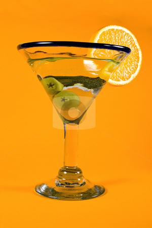 Martini Glass stock photo, Martini Glass - Isolated on Orange Background by Mehmet Dilsiz