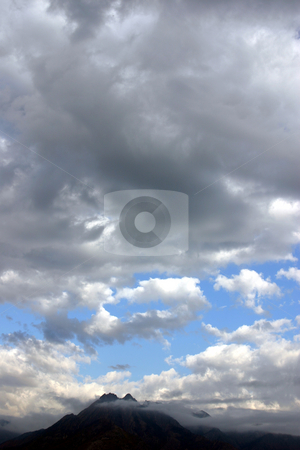 Cloudy Mountains stock photo, Clouds around the mountain by Mehmet Dilsiz