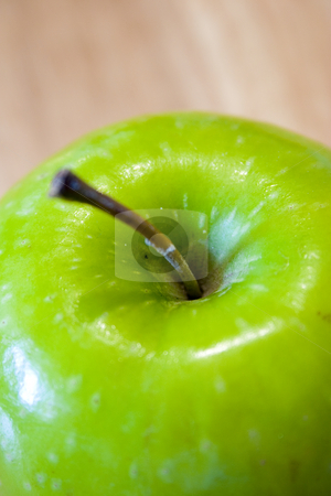 Close up on a Green Apple stock photo, Green Apple by Mehmet Dilsiz