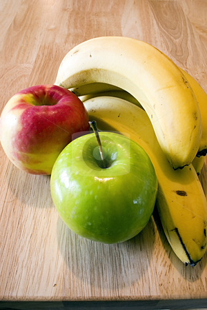 Apples and Bananas stock photo, Close up on a Red, Green Apple and Bananas by Mehmet Dilsiz