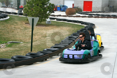 Woman on the Go Cart stock photo, Woman racing on the Go Cart by Mehmet Dilsiz