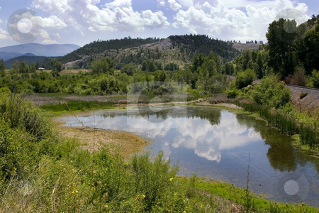 Pond, Mountains and Green in Helena Montana stock photo, Landscape View of a Pond, Mountains and Green in Helena Montana by Mehmet Dilsiz