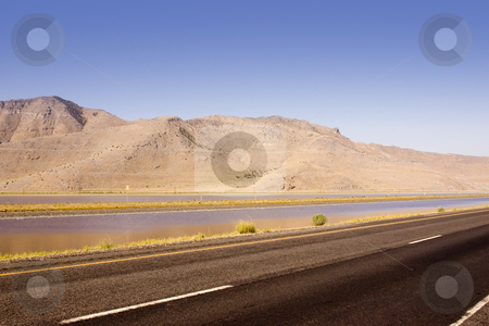 Highway, Pond and the Mountain stock photo, Highway running by a Pond and the Mountain by Mehmet Dilsiz