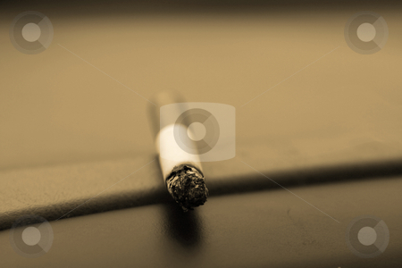 Retro Cigarette  stock photo, Single Cigarette Laying on the Deck - Retro Look by Mehmet Dilsiz