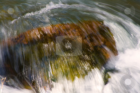 River stock photo, Flowing water in River - Close up on a Rock by Mehmet Dilsiz