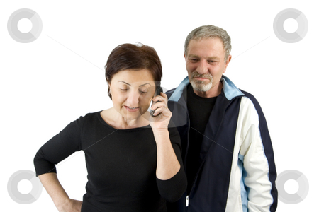 Wife on the Phone while Husband Waiting for the News stock photo, Wife on the Phone while Husband Waiting for the News - Isolated by Mehmet Dilsiz