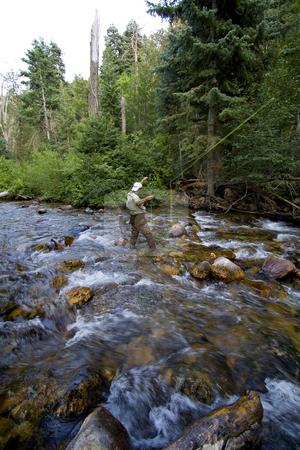 Fisherman in River stock photo, Fisherman in River by Mehmet Dilsiz