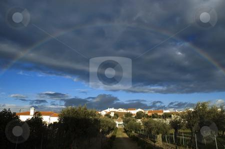 Rainbow  stock photo, Rainbow over a small village in Alentejo, Portugal by Manuel Ribeiro