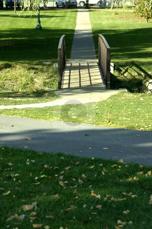 Wooden Bridge in the Park stock photo, Wooden Bridge in a Park by Mehmet Dilsiz