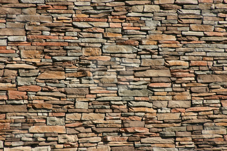 Rock Wall stock photo, Rock Wall as a background by Mehmet Dilsiz