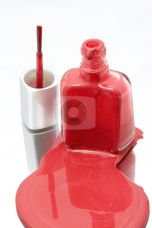 Nail Polish Spilling on a Mirror with the Brush Standing stock photo, Isolated Nail Polish Spilling on a Mirror with the Brush Standing by Mehmet Dilsiz