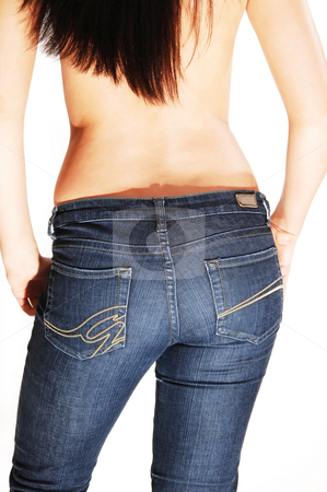 Topless woman in jeans. stock photo, Young topless woman standing with her back to the camera, shooing the nice butt in the blue jeans and the hands in the pocket, over white. by Horst Petzold