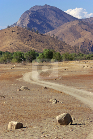 Curved Path Below Mountains stock photo,  by Kristine Keller