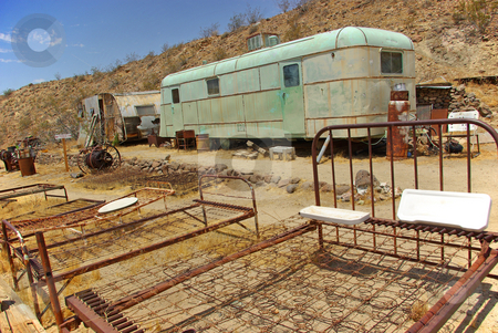 Random Mojave 4 stock photo, Rusty old items fill an old campsite in the Mojave Desert. by Kristine Keller