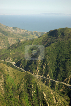 Malibu Canyon highway stock photo, A high view of the highway stretching through Malibu Canyon to the Pacific Ocean.  Los Angeles is faintly visible beyond. by Kristine Keller