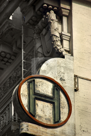 Deco Hotel Sign stock photo, Neoclassical motifs adorn a once-elegant hotel in downtown Los Angeles. by Kristine Keller