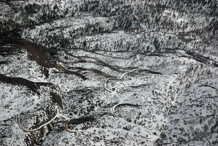 Snow-Covered Road, Aerial View stock photo, A curvy snow-covered road in Southern California, late winter. by Kristine Keller