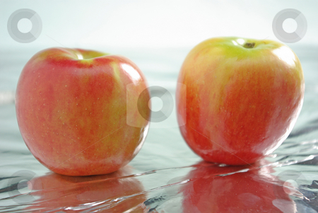 Apples 2 stock photo, Two apples on a shiny surface. by Kristine Keller