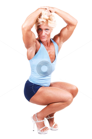 Bodybuilding woman. stock photo, A blond muscular bodybuilding girl kneeling in the studio shooing her  strong arms, in high heels, and shooing the biceps, over white background. by Horst Petzold