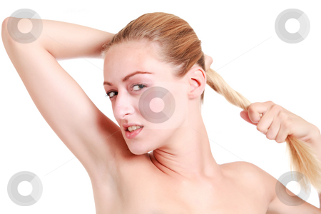 Portrait of  young blond pulling her hair stock photo, Beautiful blond young woman pulling her hair while looking at you by Frenk and Danielle Kaufmann