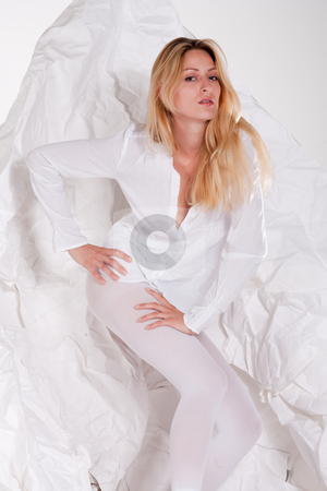 Beautiful blond girl posing high fasion in white clothes stock photo, Beautiful blond young woman in legging and blouse posing high fashion style by Frenk and Danielle Kaufmann
