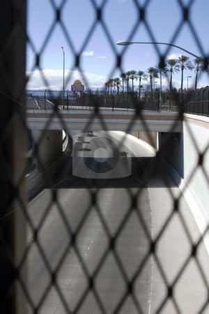 Highway Behind the Fences in Las Vegas  stock photo, Highway Behind the Fences in Las Vegas -Road in focus by Mehmet Dilsiz