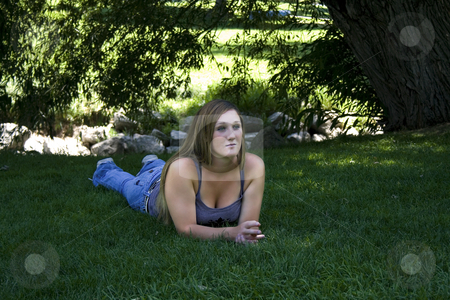 Beautiful Girl in the Park stock photo, Close up on a Beautiful Girl Laying Down in the Park by Mehmet Dilsiz