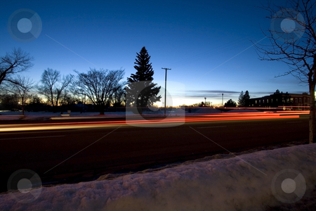 Night Shot of a Street in Winter Time stock photo, Night Shot of a Street in Winter Time with Snow on the Ground by Mehmet Dilsiz