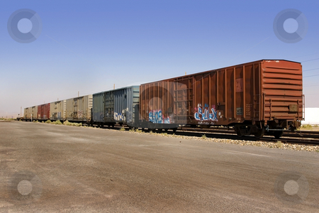 Old Wagons with Graffiti stock photo, Old Wagon with Salt Pile and Clear Skies on the Background by Mehmet Dilsiz
