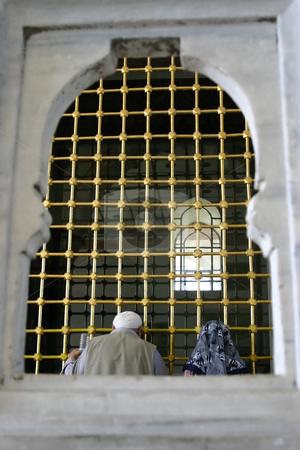 Praying couple stock photo, Praying couple in Topkapi Palace by Mehmet Dilsiz